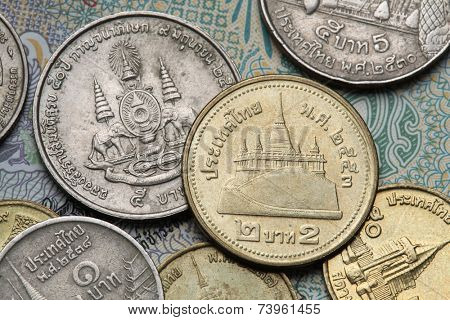 Coins of Thailand. Wat Saket Temple in Bangkok, Thailand, and the Royal Golden Jubilee Emblem depicted in Thai baht coins.