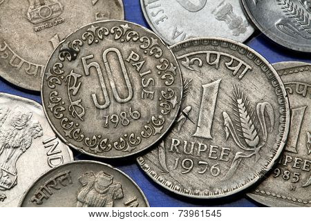 Coins of India. Indian one rupee and fifty paise coins.
