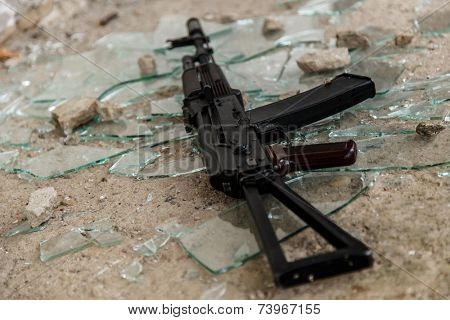 War, conflict. Rifle on the floor