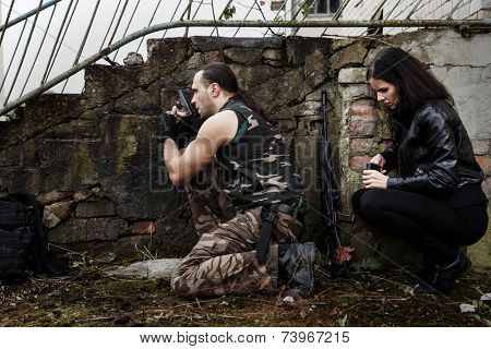 War, conflict. Guy with girl on a battlefield
