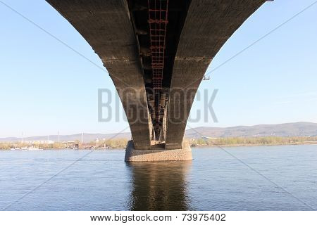 A bottom view of the Communal bridge across Yenisey River on a hot sunny day in Krasnoyarsk city