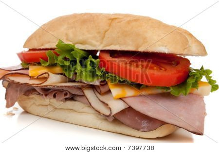 Ham And Turkey Sandwich On A Hoagie Bun On White
