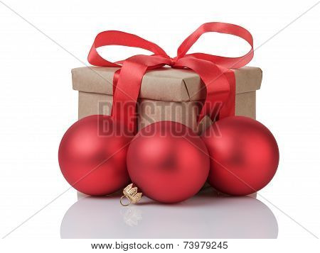 Wraped Gift Box With Red Bow And Christmas Balls