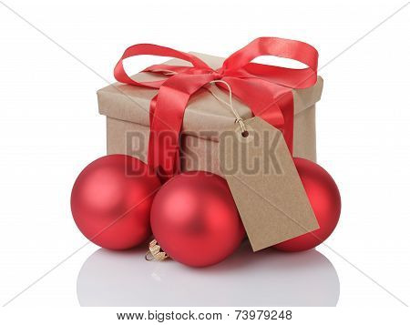 Wraped Gift Box With Red Bow, Christmas Balls And Tag