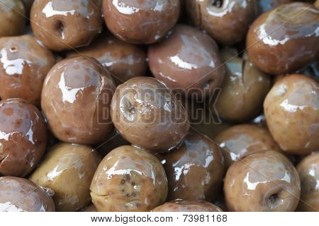 Brownish Olives In Oil Close Up.