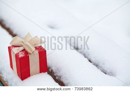 gift box in the snow outdoors