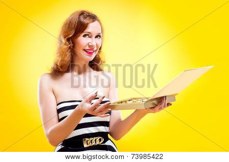 Portrait of beautiful girl with candy