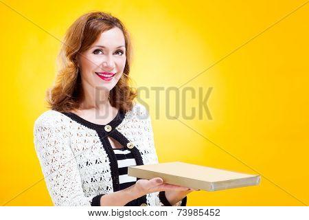 portrait of woman holding chocolate box