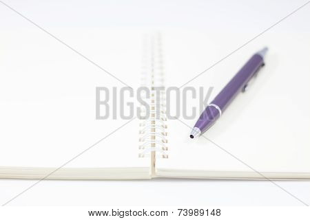 Pen And Spiral Notebook Isolated On White Background