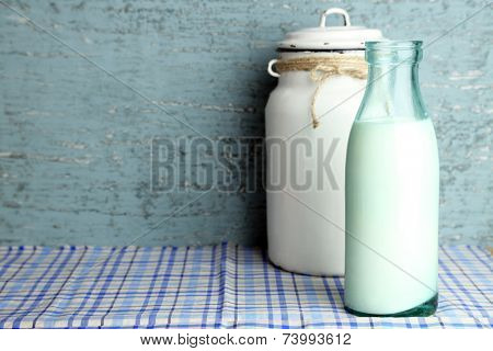 Retro still life with tasty rustic milk, on table