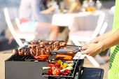 stock photo of bbq party  - Young friends having barbecue party - JPG