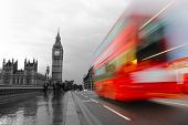 foto of westminster bridge  - London the UK. Red bus in motion and Big Ben the Palace of Westminster. in retro monochrome style ** Note: Visible grain at 100%, best at smaller sizes - JPG