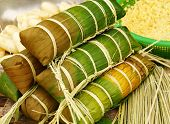 stock photo of bamboo leaves  - Banh tet for Lunar New Year Vietnam Tet food make from glutinous rice meat green bean cover by banana leaf tie by bamboo rope is traditional Vietnamese dishes - JPG