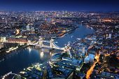 picture of bridge  - London at night with urban architectures and Tower Bridge - JPG