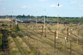 pic of railcar  - Railway tracks and trains standing on siding in Poznan Poland - JPG