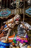 pic of carousel horse  - Two horses in a carousel in a fun park