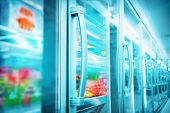 stock photo of frozen food  - Interior of empty supermarket aisle and lights