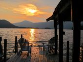 stock photo of dock a lake  - This photo was taken by me at sunset on Lake George,