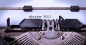 stock photo of four  - Vintage inscription Chapter 4 made by old typewriter chapter four - JPG