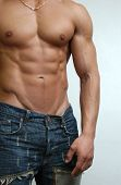 stock photo of pubis  - Muscular male model in jeans - JPG