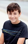 foto of preteen  - Nice preteen boy smiling with a black t - JPG
