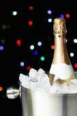 pic of champagne color  - Bottle of champagne in bucket with ice - JPG