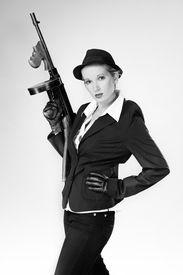 image of tommy-gun  - Mafia style fashion studio portrait  - JPG