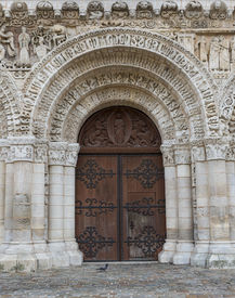 foto of poitiers  - Wooden door of the church of Poitiers in France - JPG