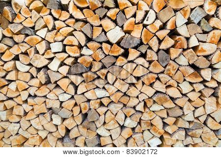 Pile of firewood as tree trunks