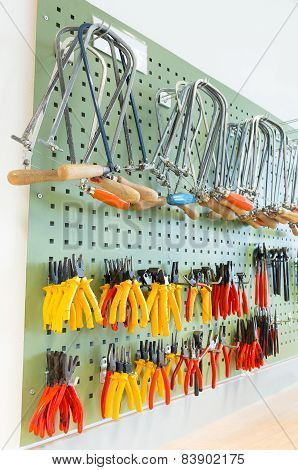Pliers and tools hanging on wall