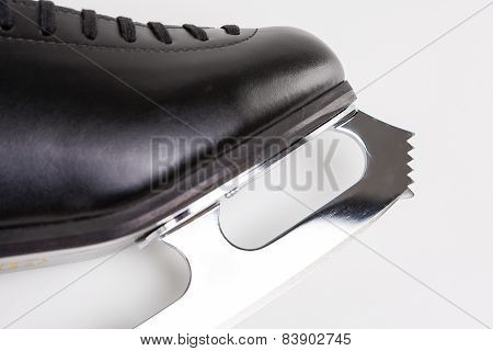 Figure Skating Concept: Closeup Of Professional Sharp New Male Figure Skate Blade. Over White Backgr