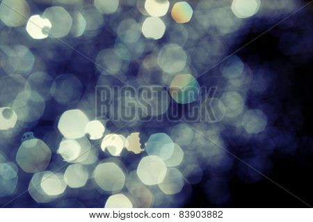 Abstract defocused background of multicolored spots of light.