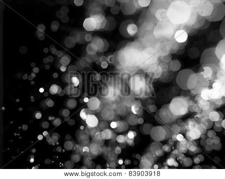 Stylized snow or rain drops glitter. Abstract circular bokeh background of Christmaslight