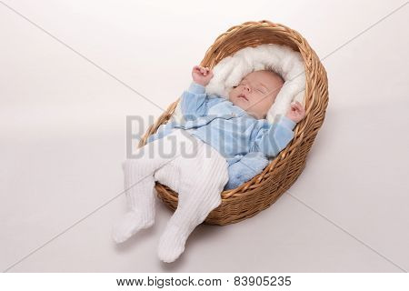 New born baby sleeps in basket