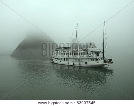 Floating Hotel In The Ha Long Bay At The Foggy Morning