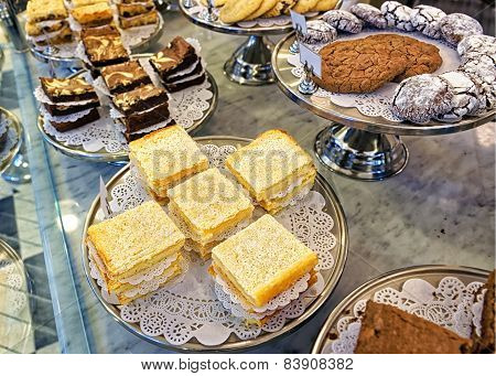 Assorted Cookies And Cakes On The Bakery Storefront