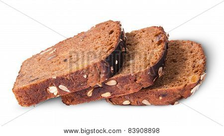 Three Slices Of Unleavened Bread Laid Out With Seeds