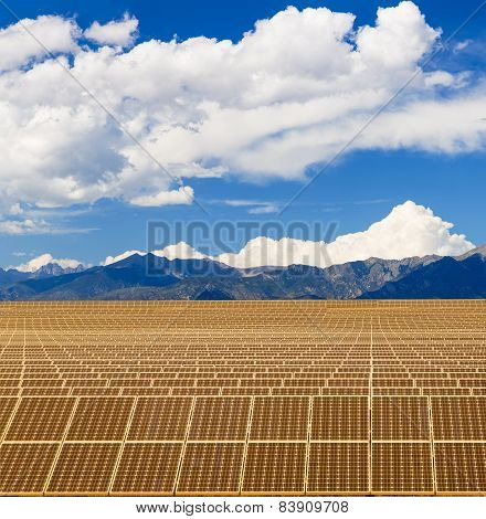 Solar Panels In Sun Under Mountains