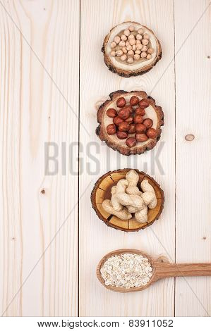 Nuts and oat on wooden table