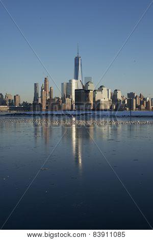 Winter Manhattan skyline reflected on the ice