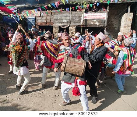People Dancing And Playing On Drums - Nepal