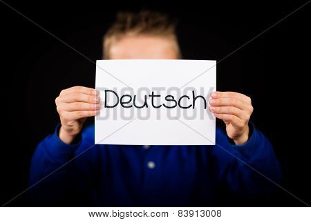 Child Holding Sign With German Word Deutsch - German In English