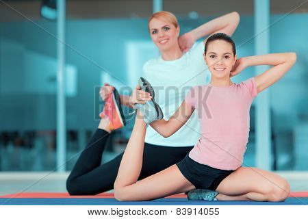 Mother and teenage girl at sports club