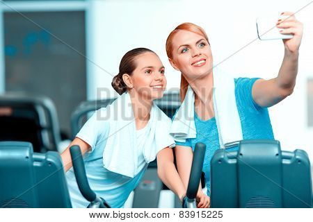 Cute teenage girl and her mom at sports club