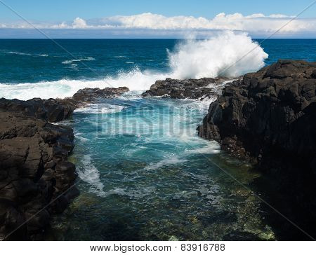 Waves Hit Rocks At Queens Bath Kauai