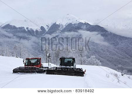 Plow snow removal equipment in the mountains of Roza Khutor Resort