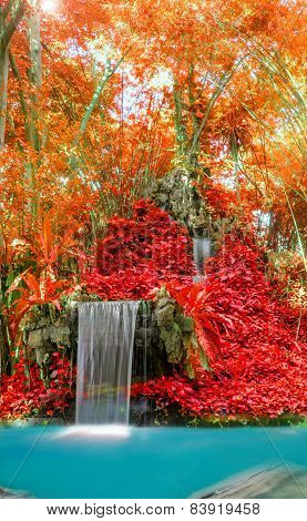 Wonderful Waterfall And Red Leaf In Deep Forest At National Park.
