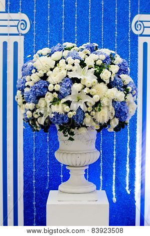Blue And White And Green Flowers In Ceramic Pot