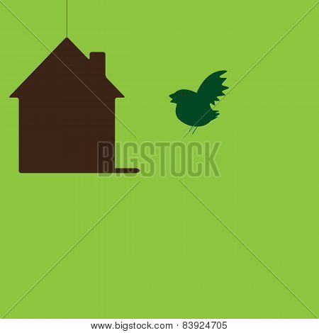 Bird Flying To His Own Hanging House