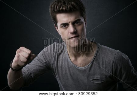 Young Man Showing Fists